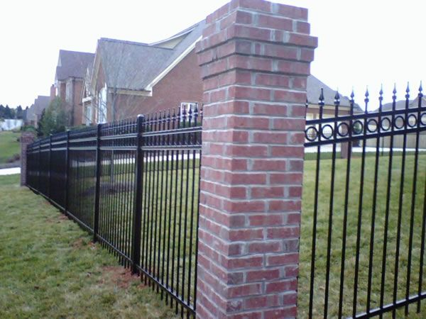 Select Wrought Iron Fence With Brick Columns To Fence Your Farm Wrought Iron Fences Offer A Formal Impression And Iron Fence Brick Columns Wrought Iron Fences
