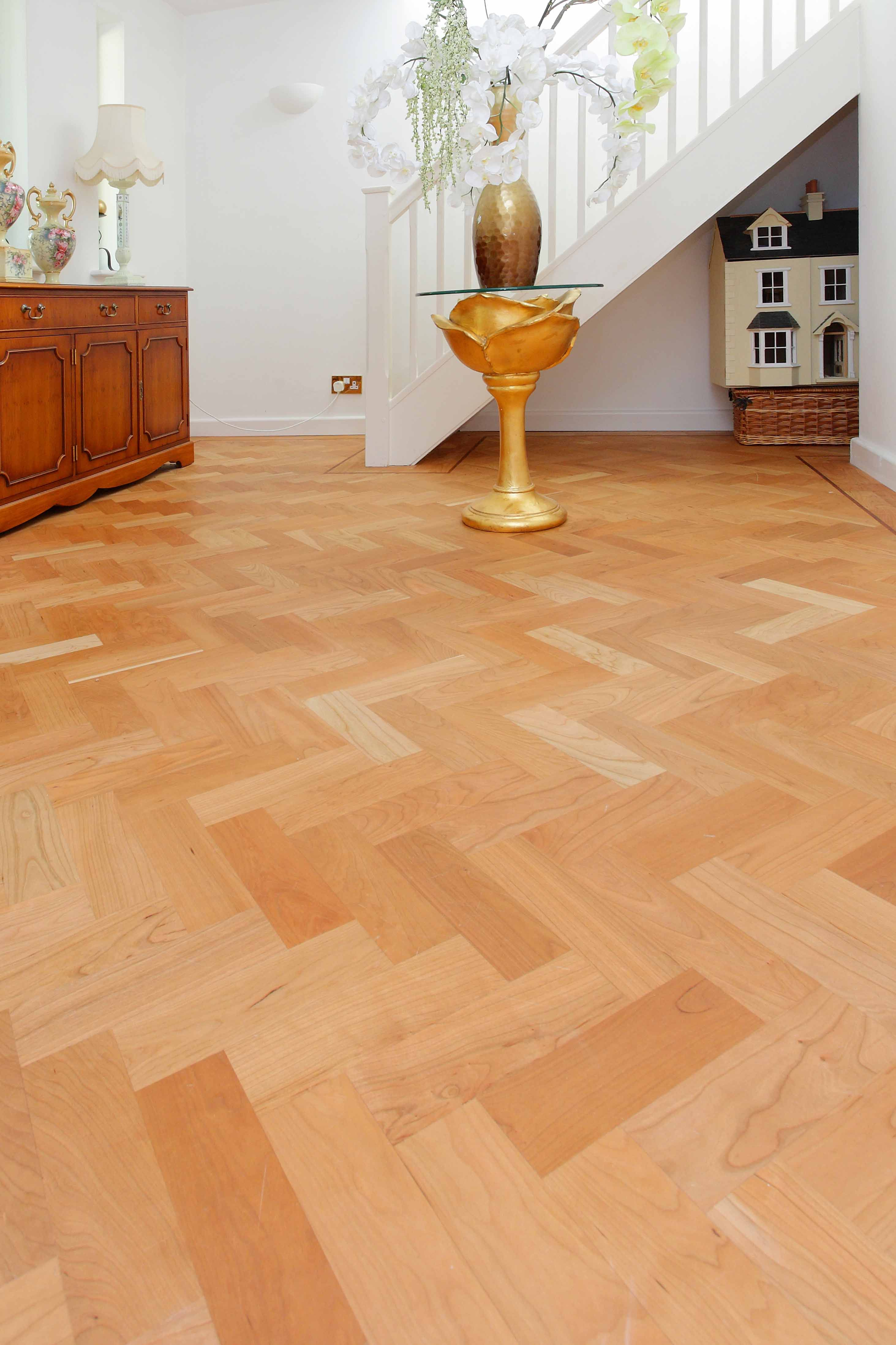 Solid Cherry Parquet Herringbone wood flooring fitted with
