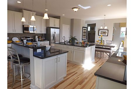 White cabinets with light wood floor Chadwick Farm by D.R. Horton ...
