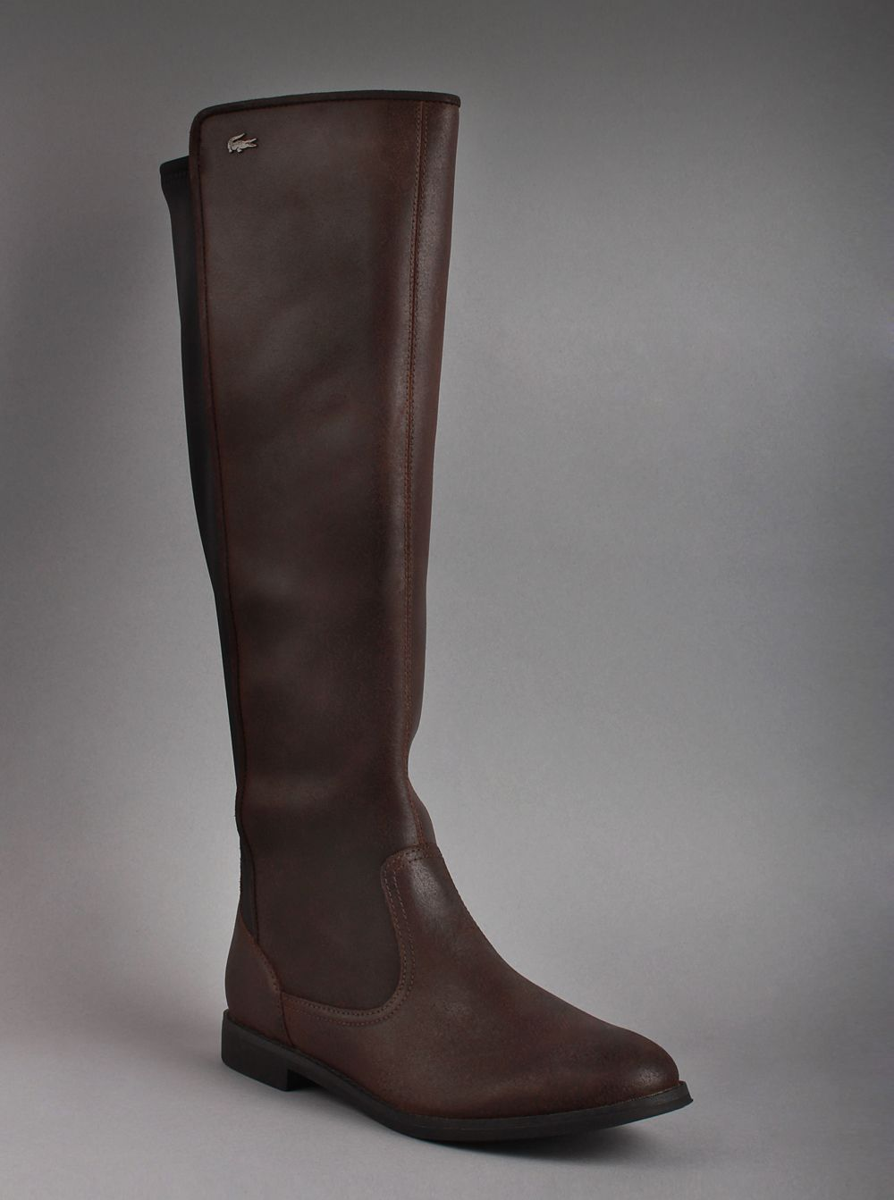 2f9145841 Lacoste® Women s Rosemont 5 Boots in Dark Brown. Take a walk this winter in  these gorgeous leather boots that show off your great sense of style.