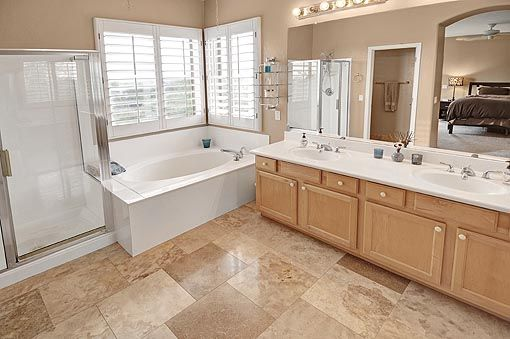 Luxurious Bath With Double Sinks A Large Roman Soak Tub Separate Shower And Walk In Closet Soaking Tub House Double Sink