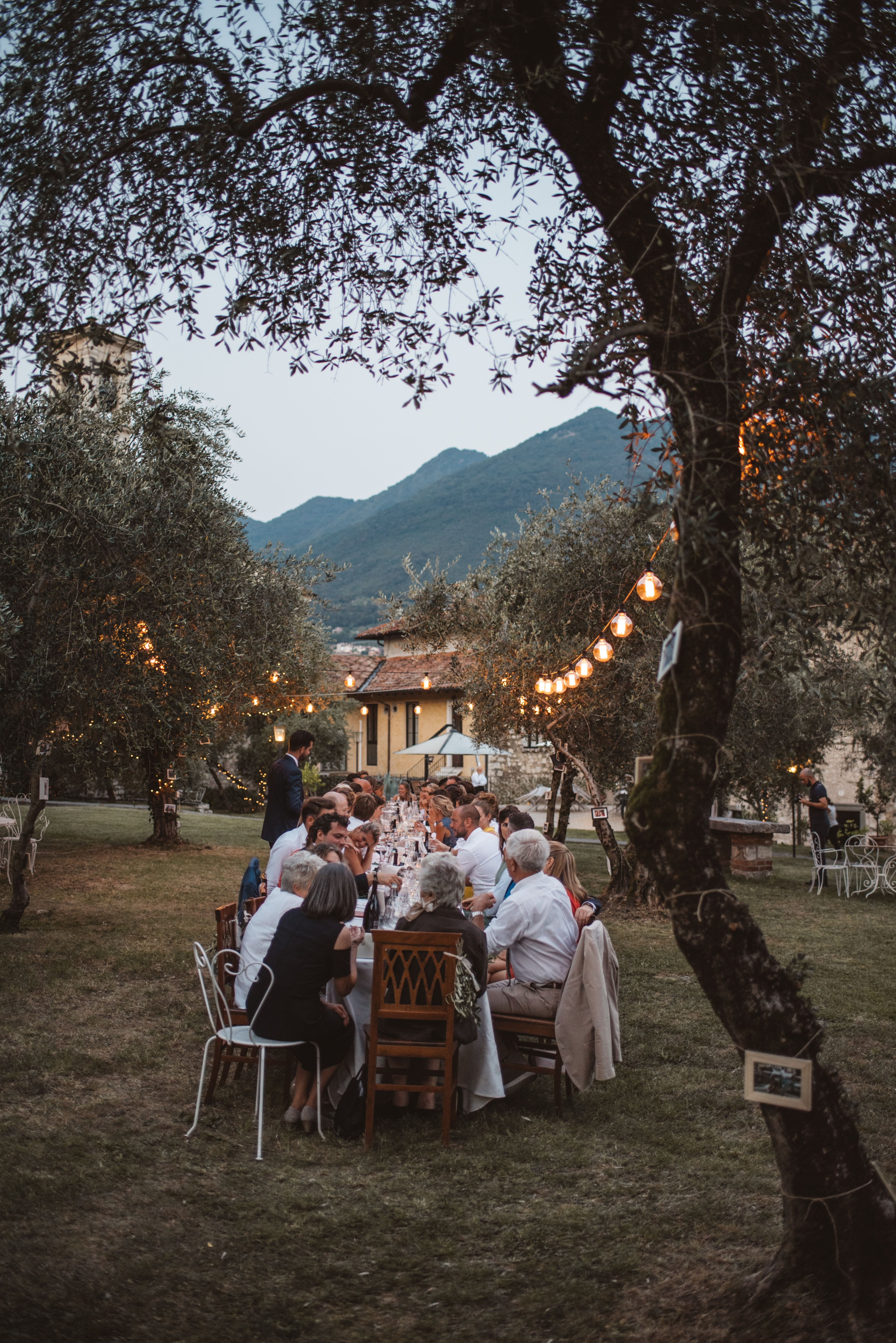 Italian wedding dinner - a long table is an italian tradition and we love it. It's like a casual family gathering at home and it makes the wedding feel so cozy. What better than to enjoy great italian wedding food outside, under the olive trees while looking at the view and having a blast! Click on the image to see the whole wedding!
