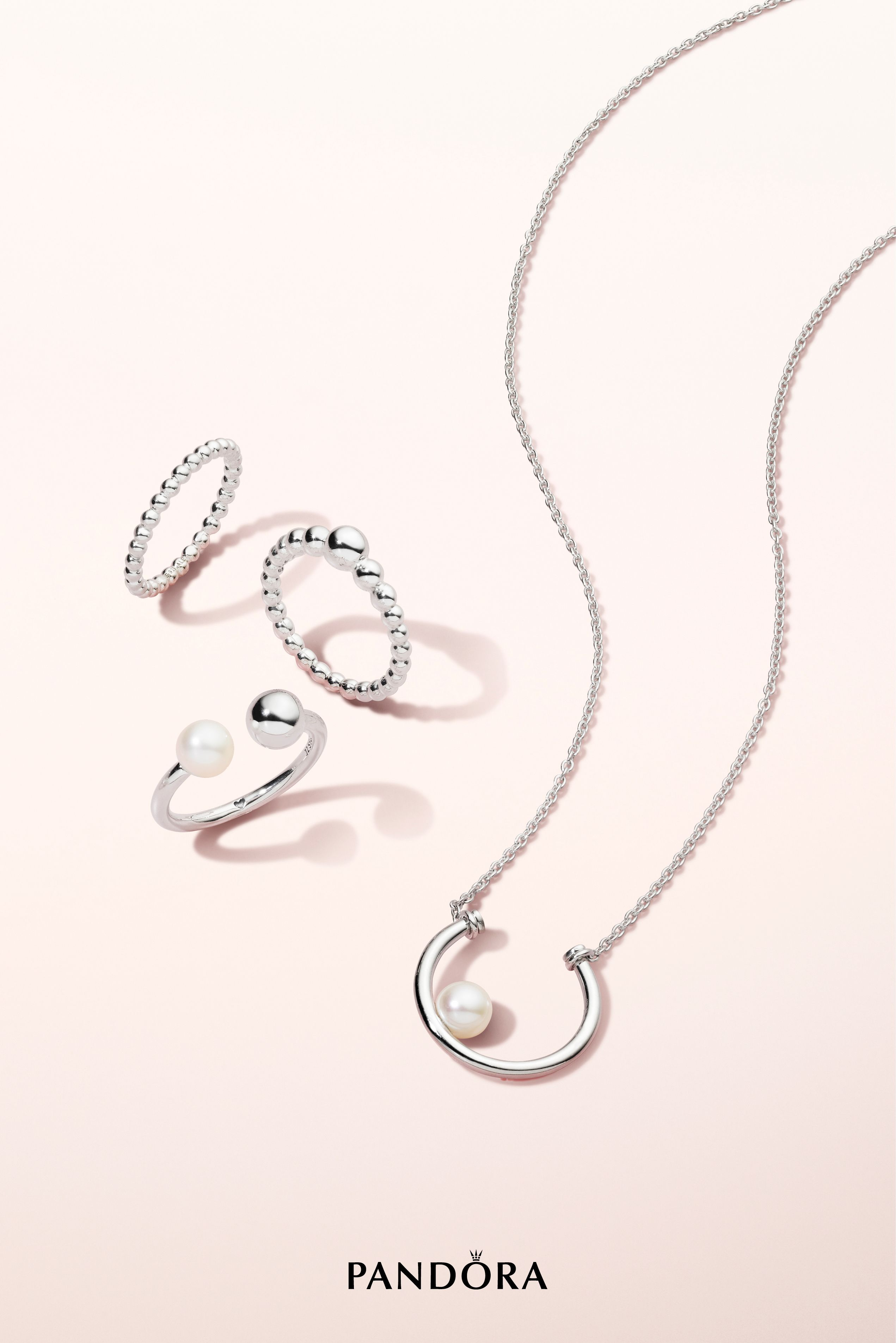 4d4a36c6ff14 A pearl of luck floats safely in the horseshoe on this sterling silver  necklace. The