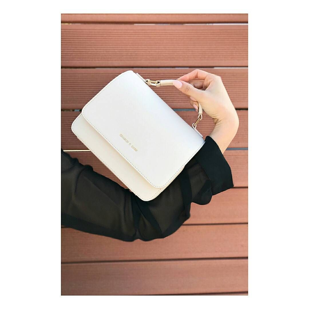 a3d5eceb2c43 CHARLES   KEITH  eleannore carries the front flap crossbody bag in ivory.   ImwithCHARLESKEITH  CHARLESKEITHSS17