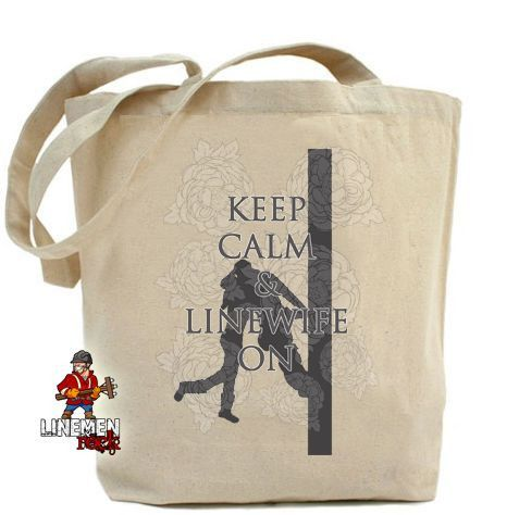 """Our keep calm and linewife on Cotton Tote bag. You'll love the fabric and the design on this one. With measurements of 14 3/8"""" x 14"""", it's a great size. The soft straps are long enough to throw it over your shoulder.  There is a second picture if you'd like to see the bag next to a person. -lineman bag"""