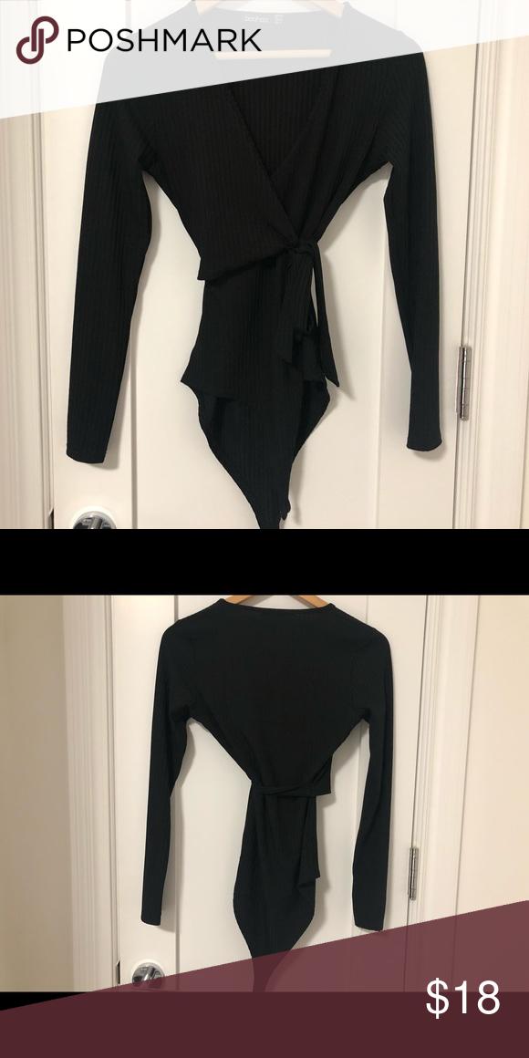 ec12ba52a8 Boohoo black wrap v-neck ribbed bodysuit Deep v-neck. Wrap top.  Form-fitting bodysuit. Ribbed texture. Barely worn! Boohoo Tops Blouses