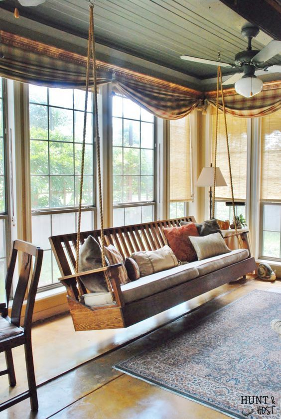 european cottage home tour sunroom with wood bench swing