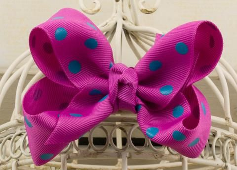 Handcrafted by LPG Originals™, your Wildberry Polka Dot Boutique Bow is made to order with great attention to detail. This classic hair bow features quality grosgrain ribbon that is made in the USA.  All ribbon ends are heat sealed to prevent fraying. This beautiful bow is hand tied and sewn to provide a durable hair accessory that will last for years.