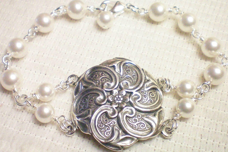 F L O R A  - Antiqued Silver Medallion Bracelet by Yourstocherish on Etsy https://www.etsy.com/listing/75706119/f-l-o-r-a-antiqued-silver-medallion
