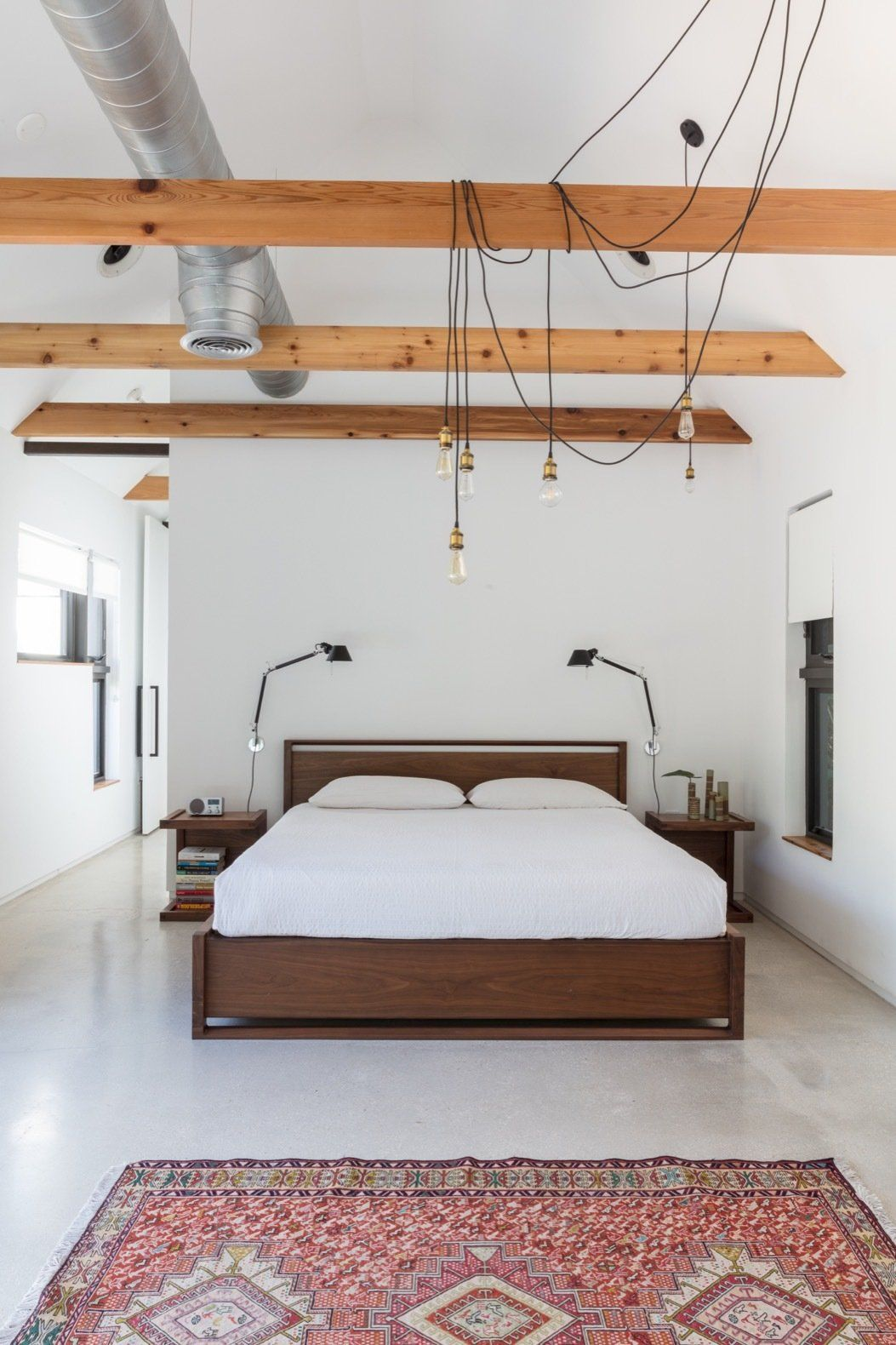Attractive Bedroom, Bed, Night Stands, Table Lighting, Recessed Lighting, Accent  Lighting, And Concrete Floor Natural Light Fills Every Room Of The Bright  And Airy ...