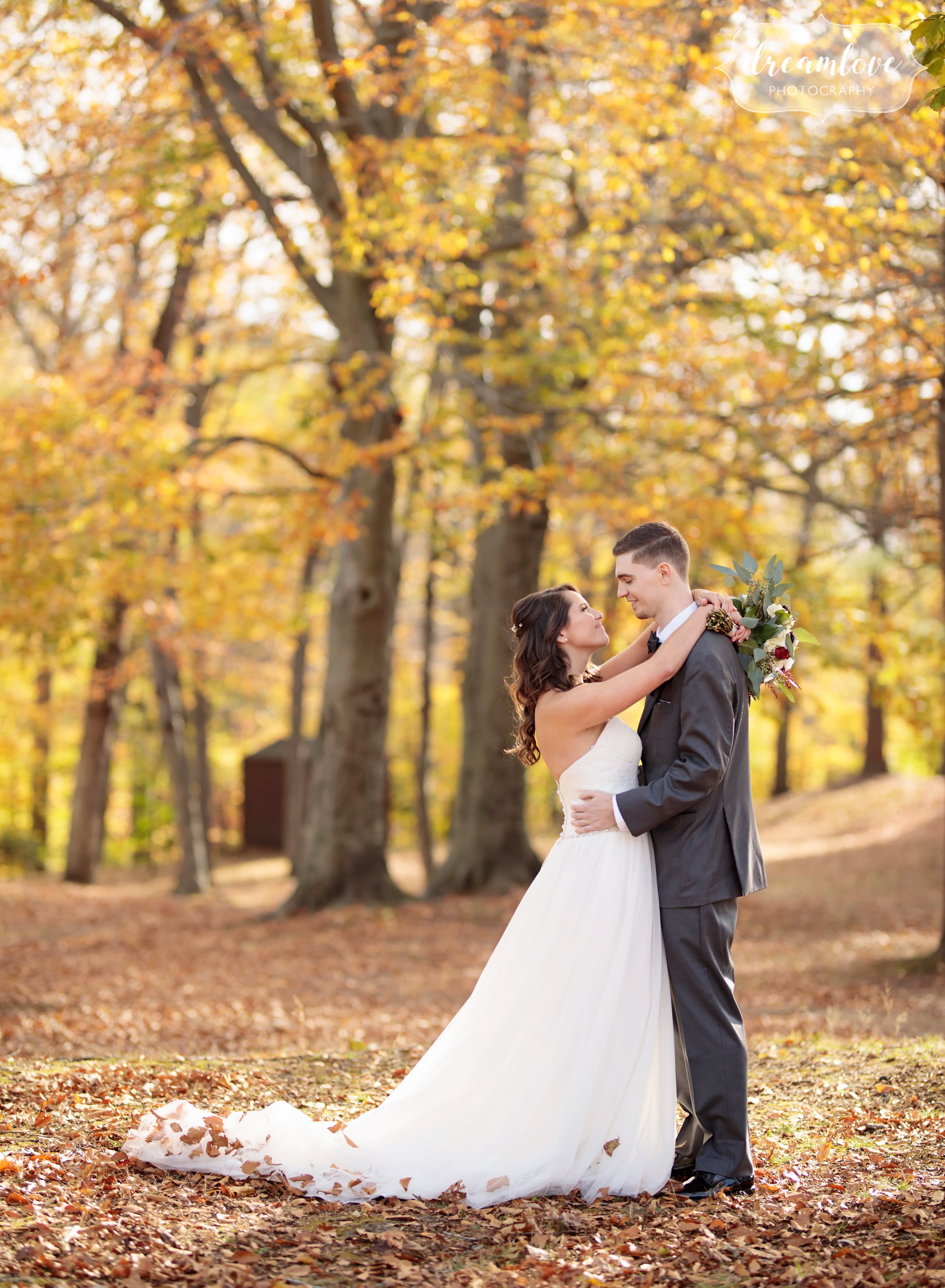 Bride And Groom Stand Under Yellow Fall Trees At Their Pavilion On Crystal Lake Wedding In November This Outdoor Venue Connecticut Is Lovely