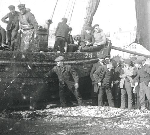 Old Fishing Boats On Beach: Fishermen On Worthing Beach. Group Of Men With Their