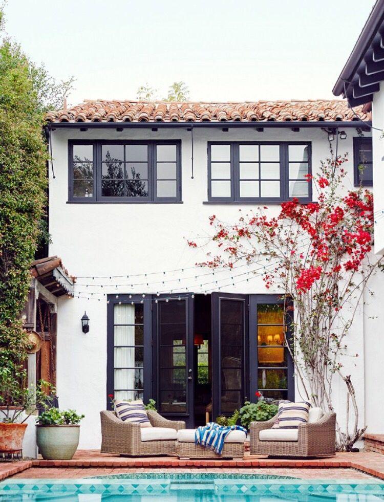 White Mediterranean House With Black Doors Windows House Exterior Spanish Style Homes Spanish House