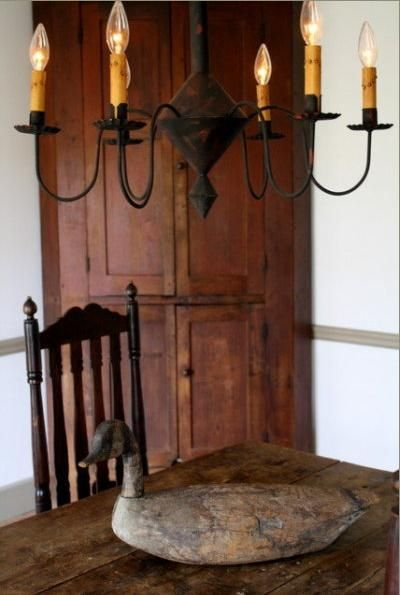 Etonnant Primitive Corner Cabinet And Wrought Iron Light For The Dining Area