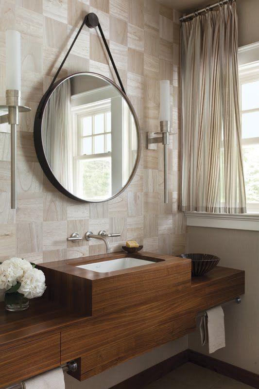 Contemporary guest bath. Modern powder room. Wood sink. Geometric wall treatment.