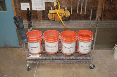 This four-bucket system at the University of Oregon is designed for capturing all glaze waste, which is then used, along with recycled clay, to make paver bricks.