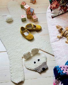 Knitted bear rug.