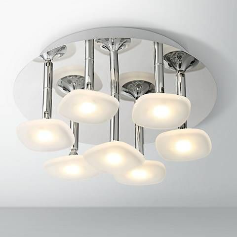 This beautiful and sophisticated led ceiling fixture features seven lights suspended from a large chrome canopy seven integrated 5 watt led modules