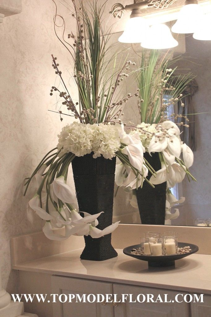 Black And White Floral Arrangements In Wicker Vase 25th