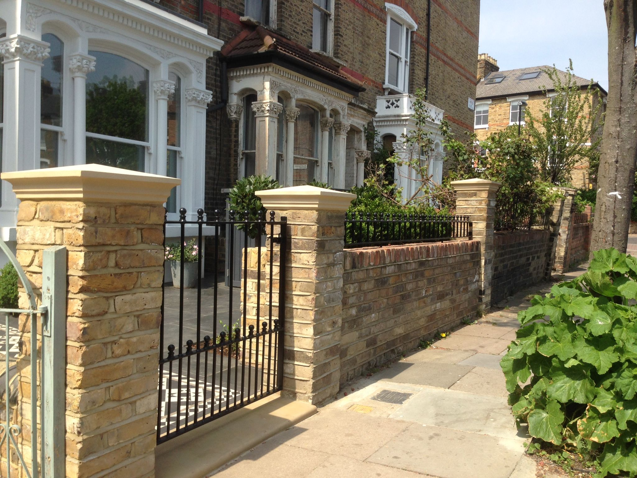 front garden yellow brick wall with buff coping and metal rail and ...