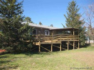 5995 County Road 212, Pine Bluffs, WY 82082-6 bed, 2 bath, 5 acres
