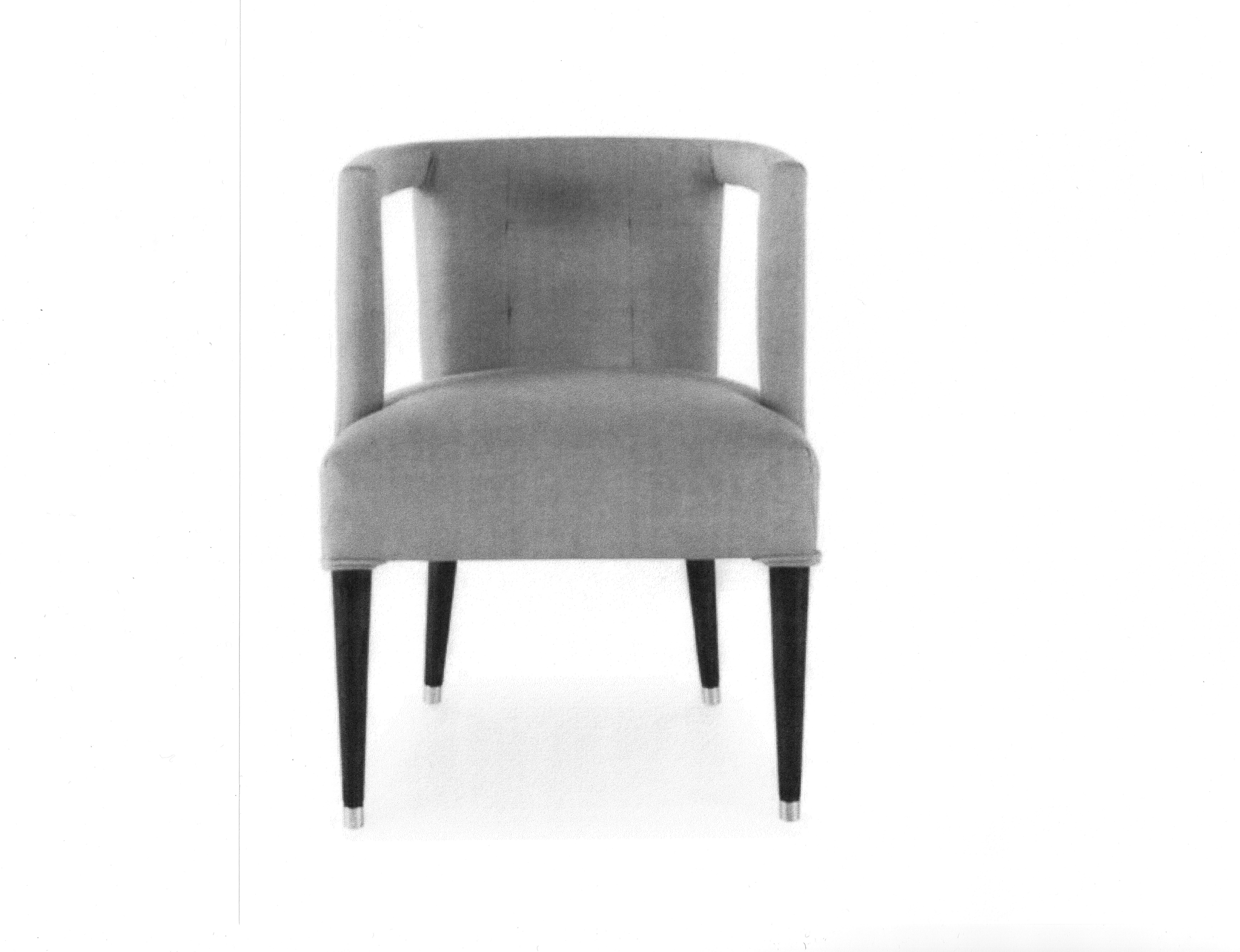 Side chair to be upholstered in ivory ribbed fabric.
