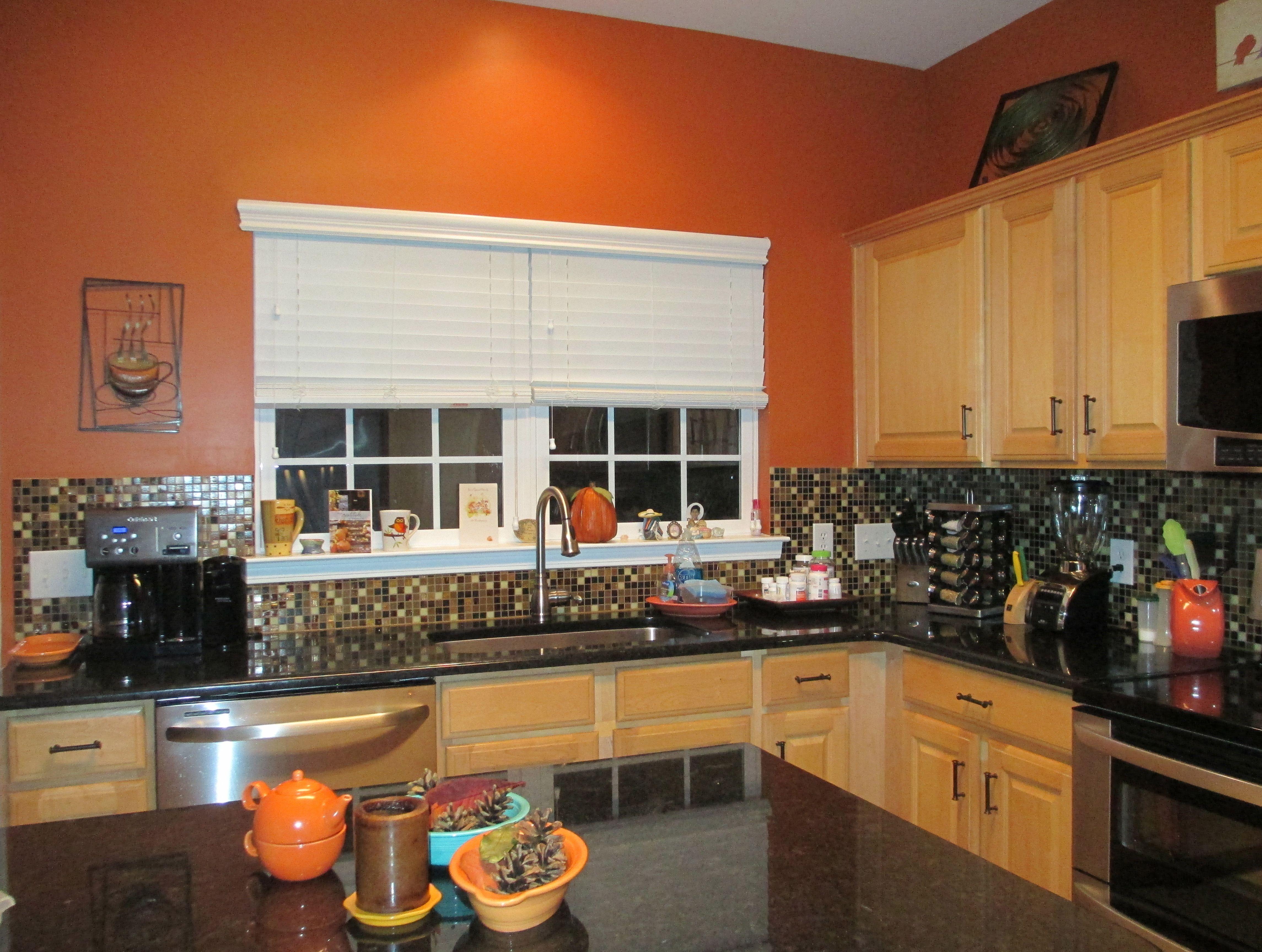 burnt orange kitchen black granite countertops glass tile