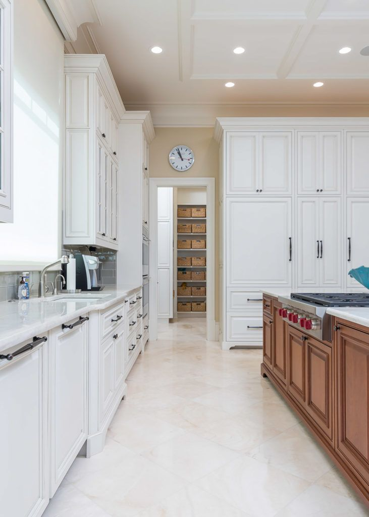 White kitchen cabinets with a stained kitchen island # ...
