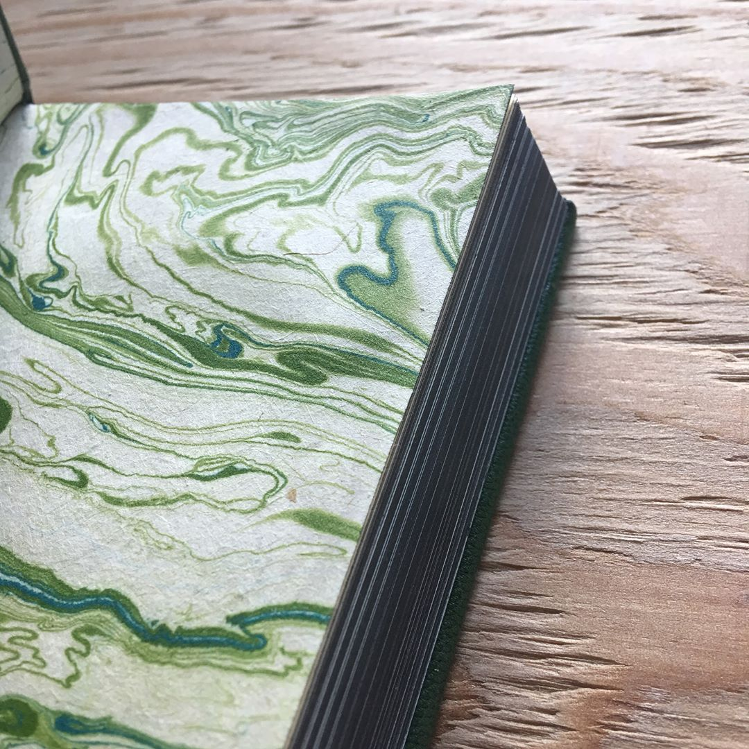 Finished this beauty. This is my book for this month's #AreYouBookEnough #bookbindingchallenge. The theme is NATURE WALK, and I found this skeleton leaf while out on a hike. I gilded it then onlaid it on this tightback leather binding. #bookbinding #leatherbook #leatherbinding #handbound #stationeryaddict #handmadeisbetter #skeletonleaf