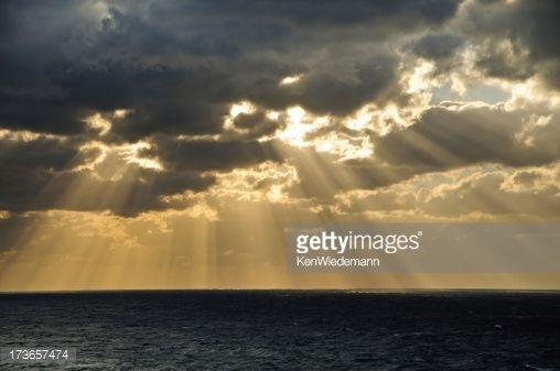 Stock Photo : Light Beams from Stormy Sky