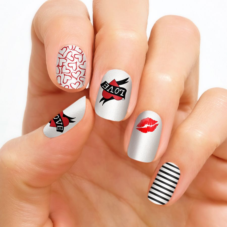 Love Park This mix of nail art includes scribbled hearts, black and ...