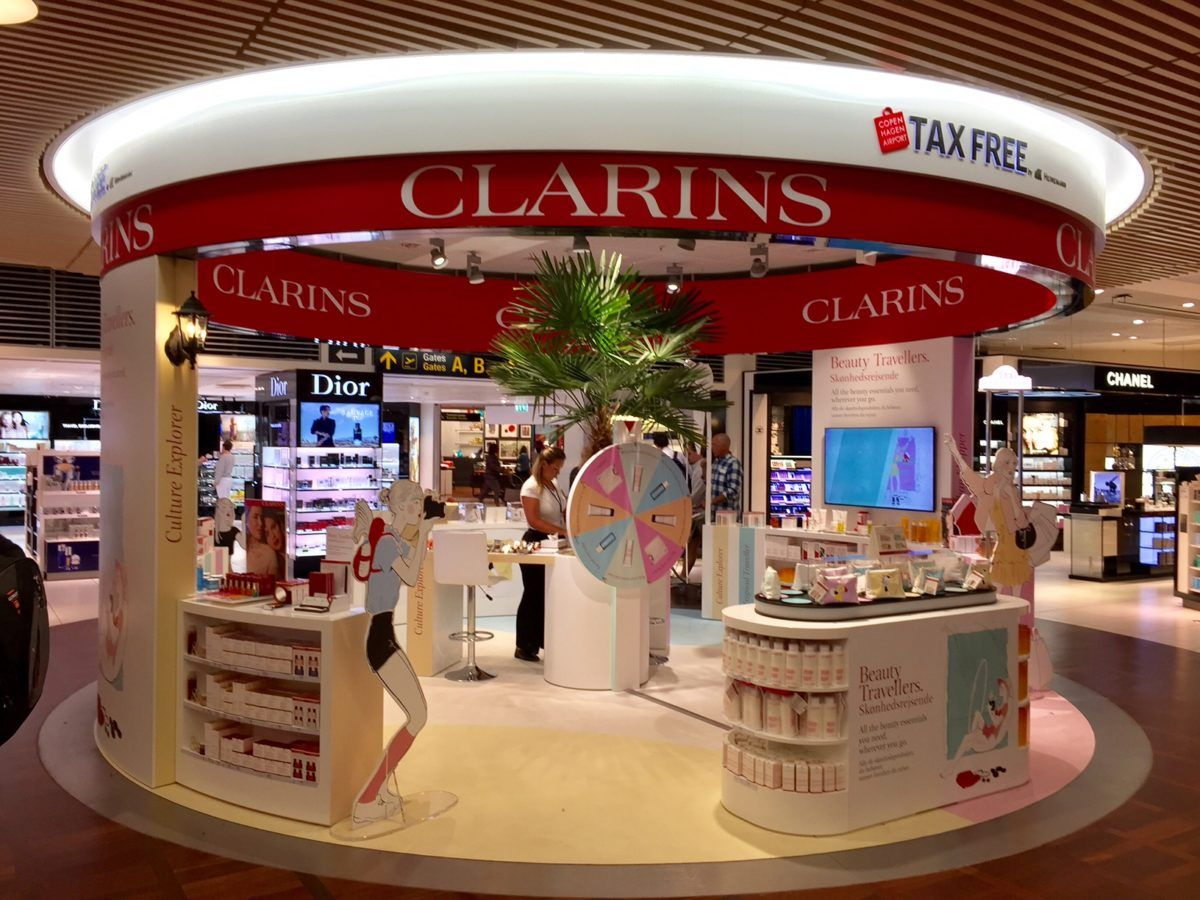 Clarins Launches Travel Themed Promotion At Copenhagen Airport Global Travel Shopping Guide Copenhagen Airport Travel Retail Travel Themes