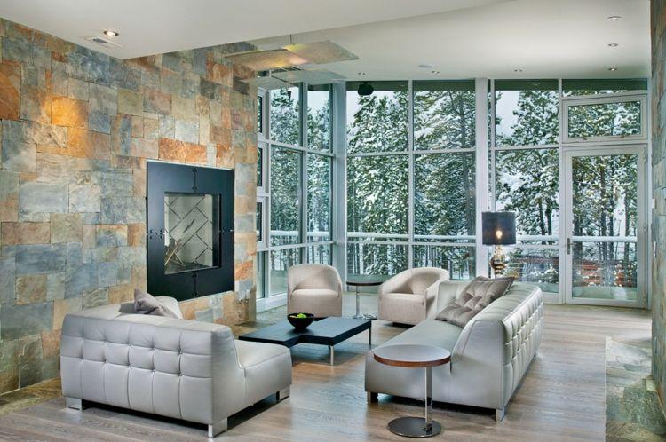 natursteinwand im wohnzimmer kamin idee weiss moebel fenster gross