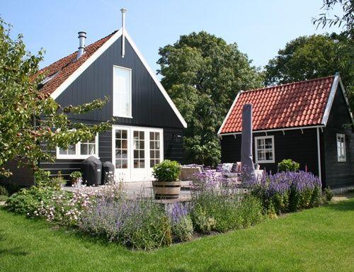 Best La Maison Boheme Black Cottage White Trim Exterior 400 x 300