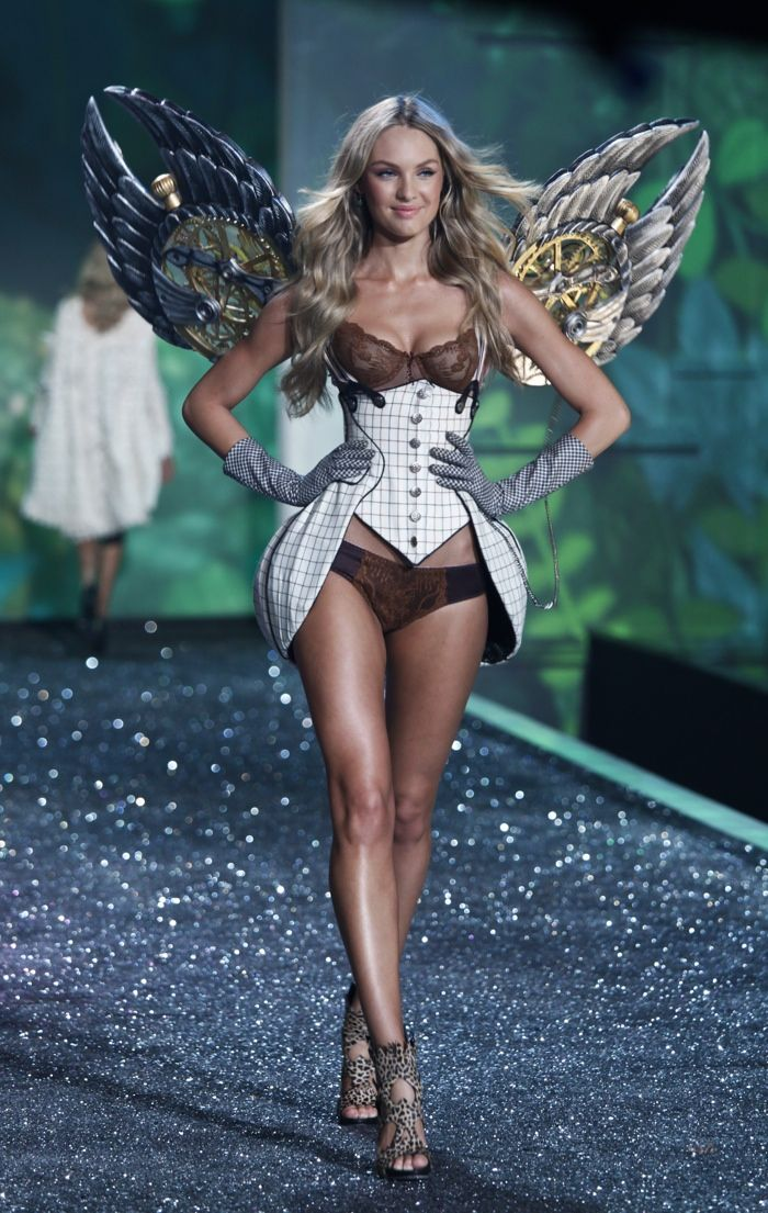 ca4f11fcf1730 Candice Swanepoel walks the Victoria s Secret Fashion Show runway in 2009.  The South African model strutted her stuff in wings and a corset inspired  look.