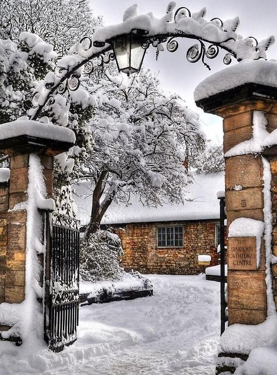 #brick #gate and house, snowy drive