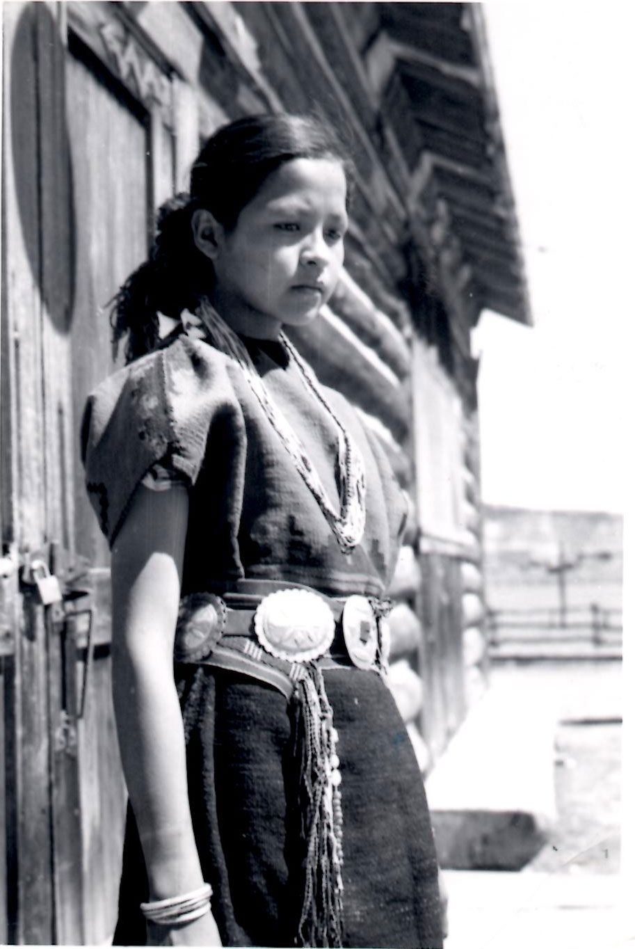 Navajo Girl Wearing Traditional Rug Dress Sash Belt And