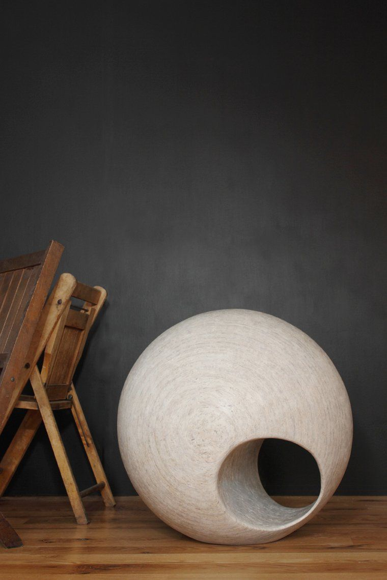 Solid spheres.    They sit flat on the ground and can be used as a seat or simply a sculptural object.