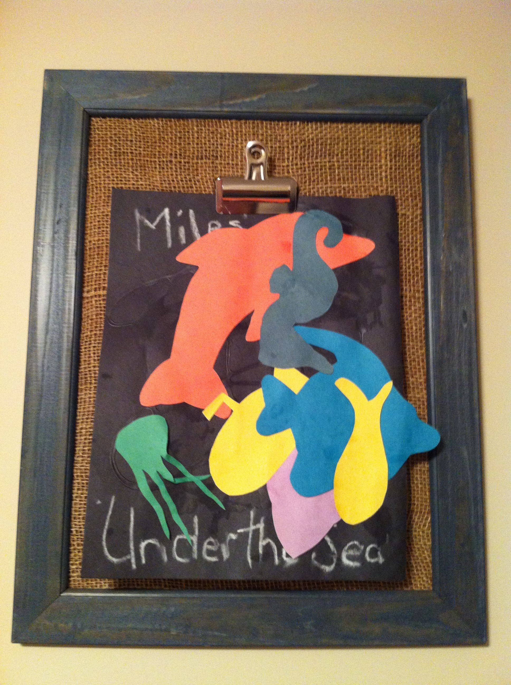 Children's art board - old frame, remove glass, add burlap backing and large metal binder clip.