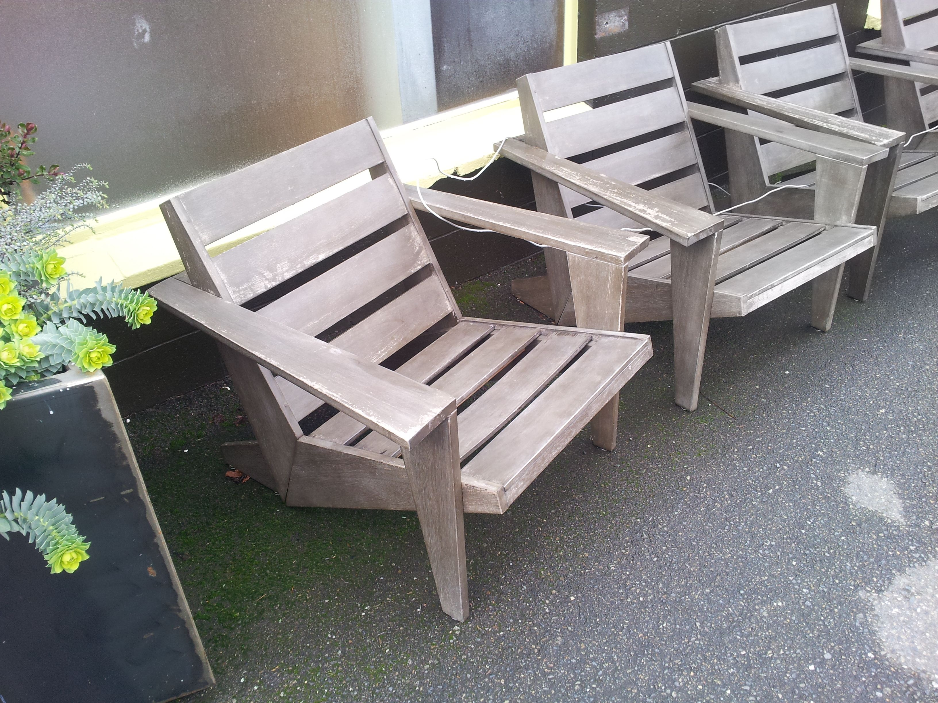 cool modern adirondack chairs from outside a coffe shop in