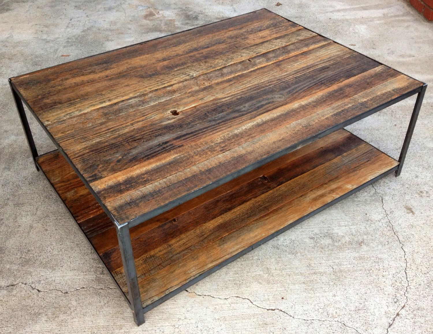 Reclaimed wood and angle iron coffee table via Wood and steel furniture