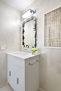 The Metallic Wallpaper And A Funky Geometric Mirror Make This Powder Room Stand Out