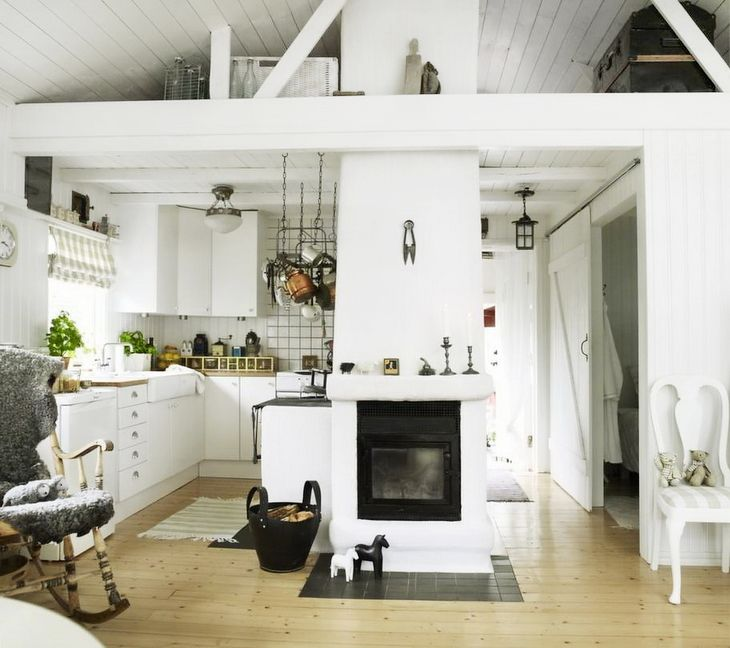exposed beams and chimney for a raised ceiling at a cottage