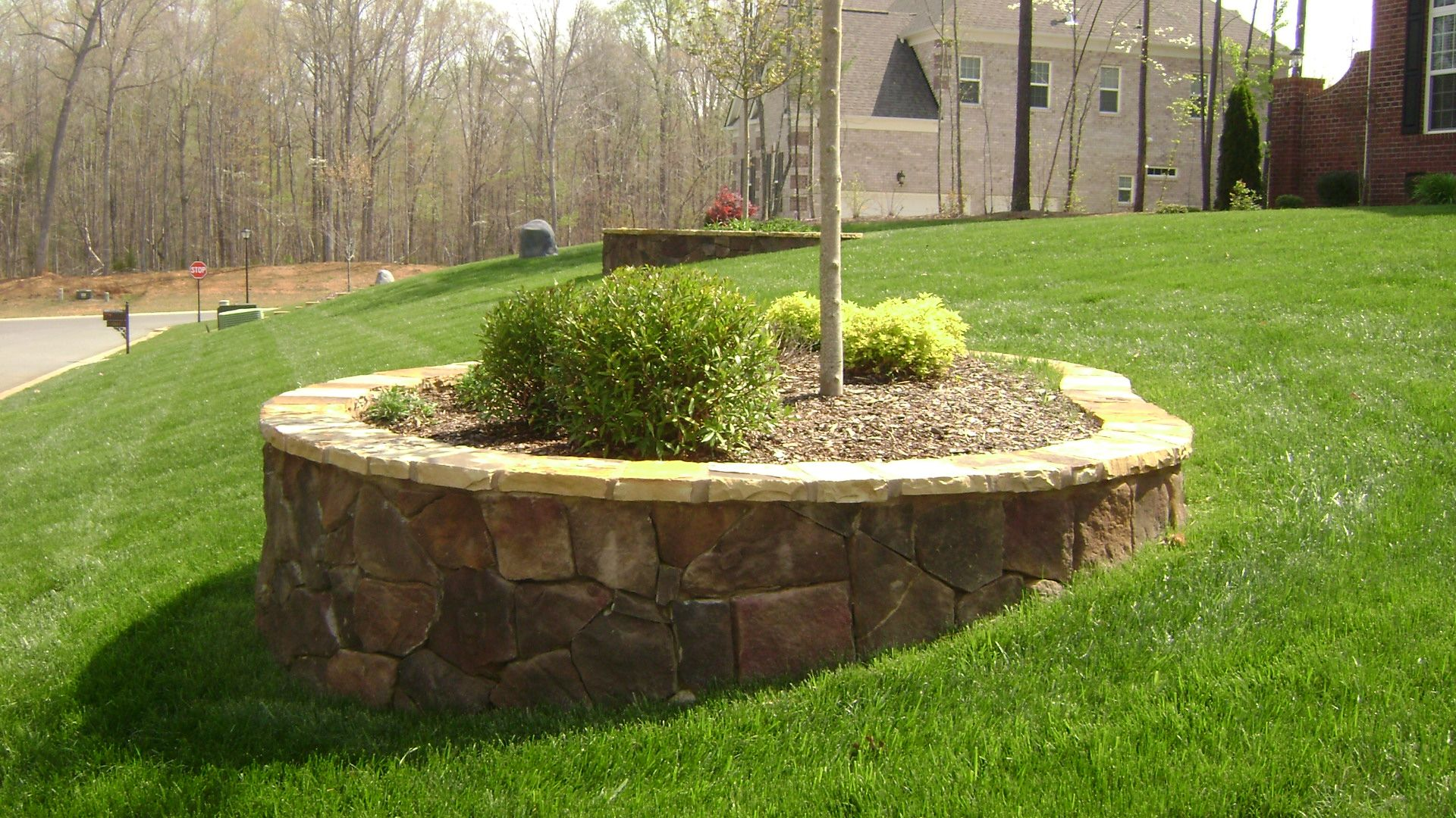 Here S A Custom Stone Planter In The Waxhaw Nc Area This Was Built Using A Concrete Base Cinder Stone Planters Front Yard Landscaping Landscape Edging Stone
