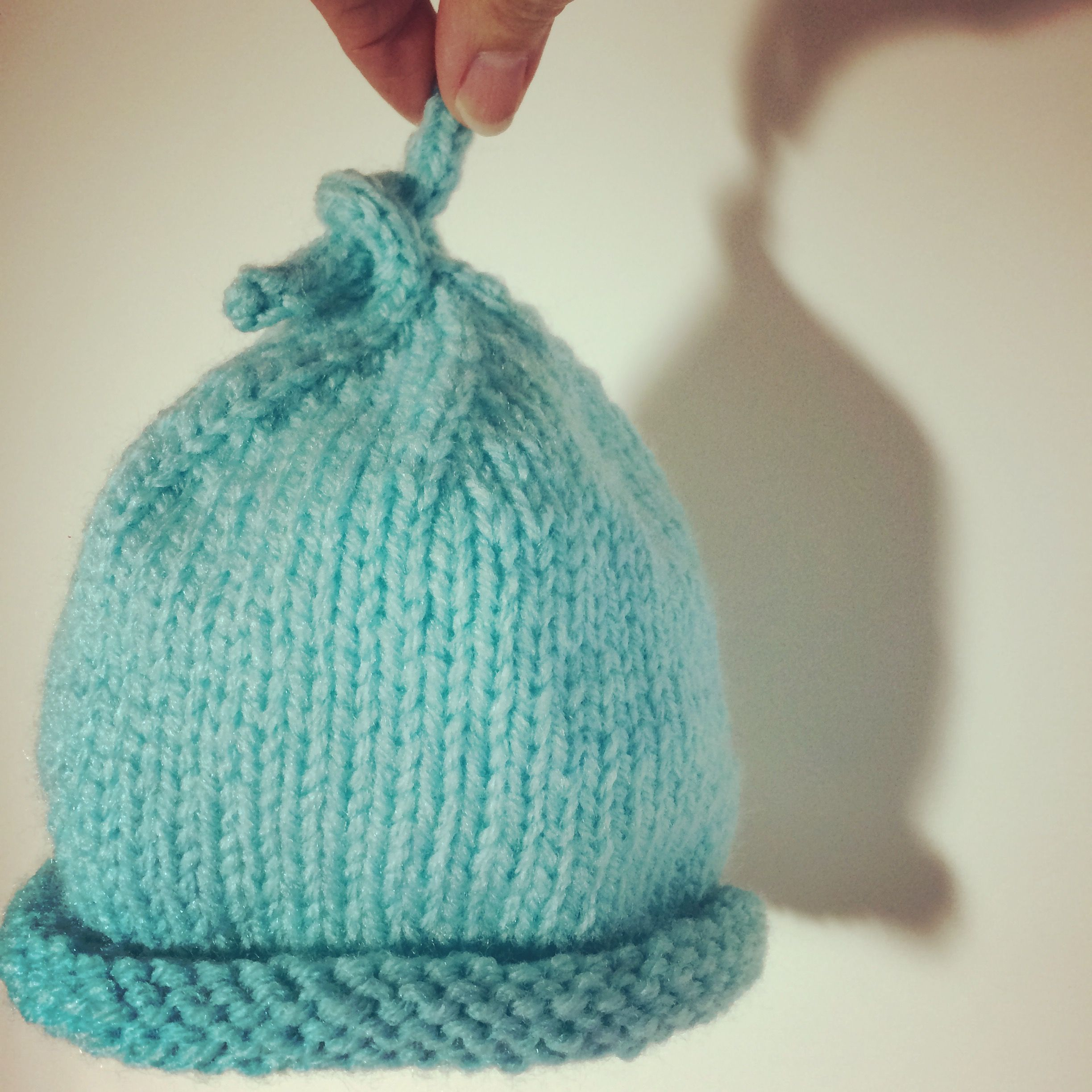 Knot-a-hat hand-knitted baby hat
