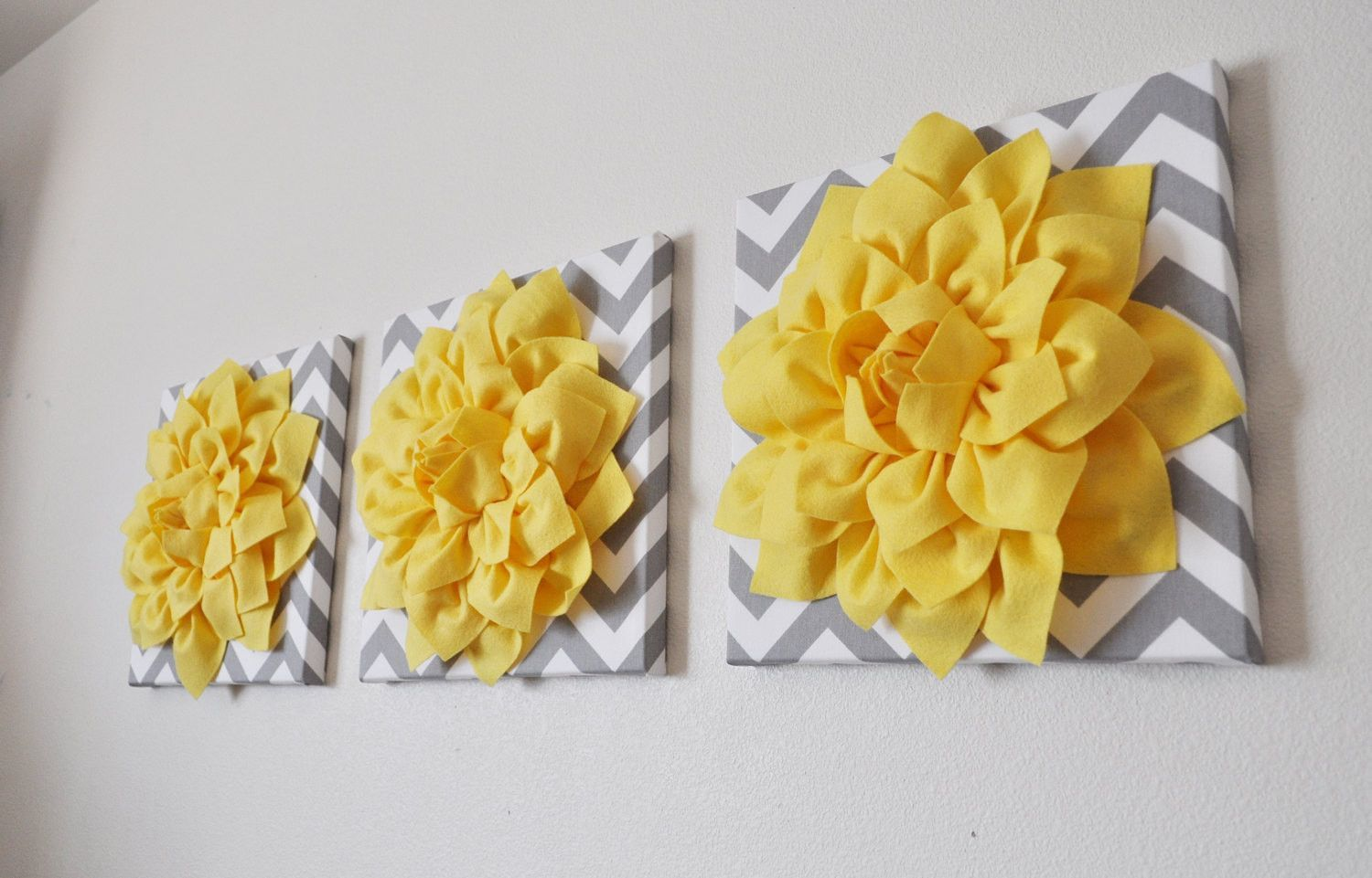 Three Bright Yellow Dahlia on Gray and White Chevron Canvases ...