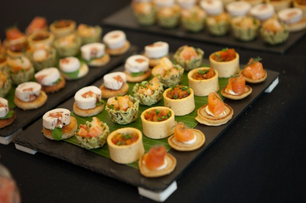 Buffet presentation of canap s at a launch party for What is a canape appetizer