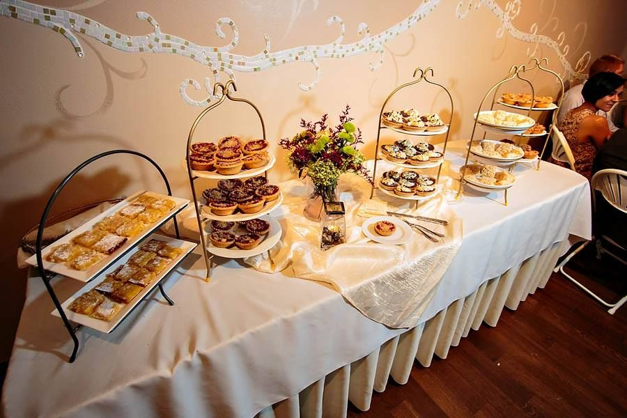 Instead of having a wedding cake, this Tapestry House couple decided to have a delicious dessert bar with lots of yummy treats!  Photo by Tom K. Photography