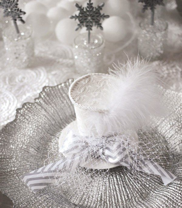 white fascinator hat place setting for an all white party
