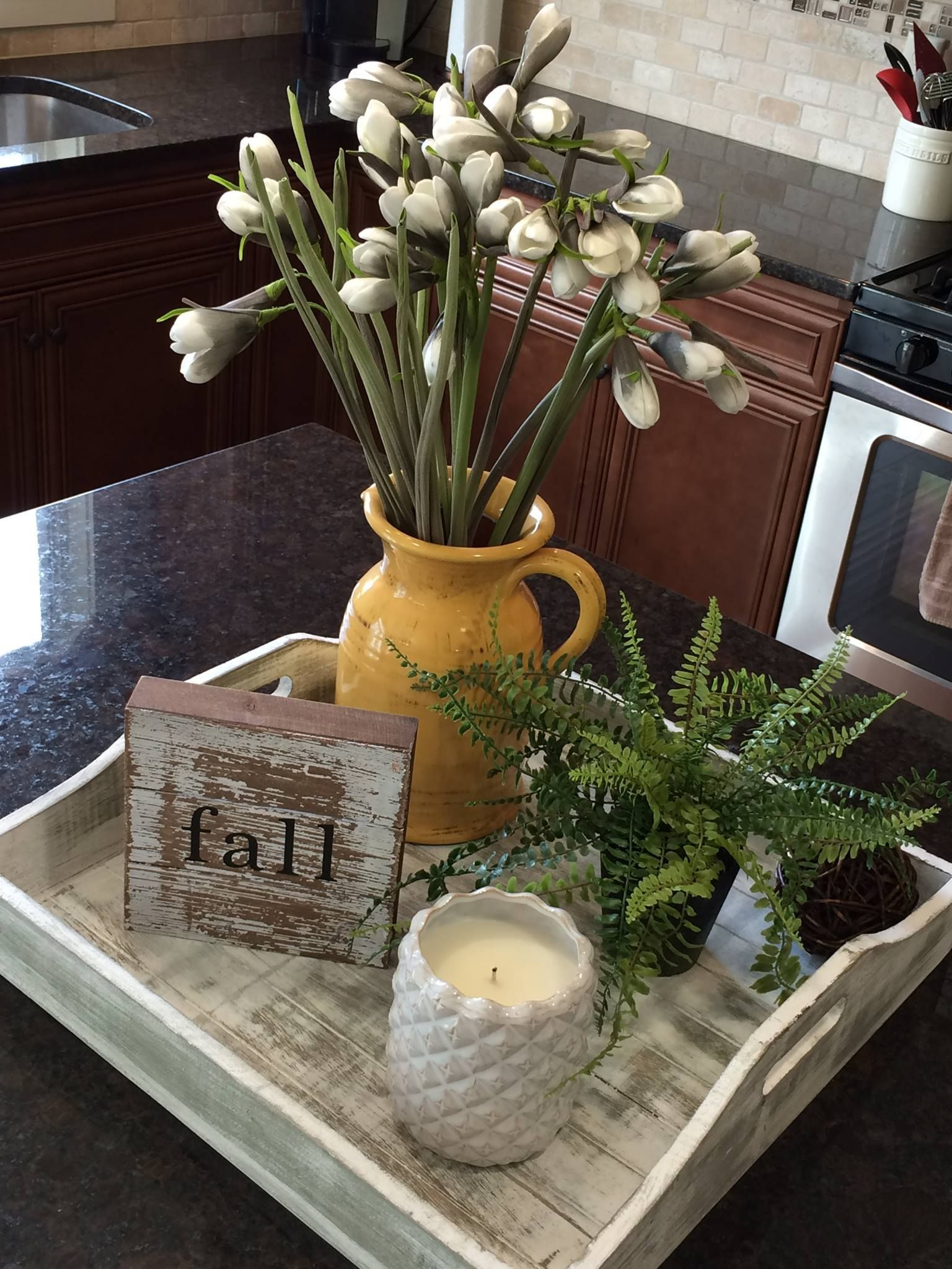 Love this decor idea for a kitchen island or peninsula! Tray